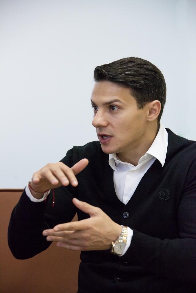 Александр Новин