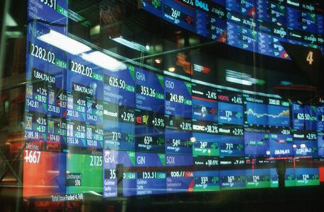 Биржи США закрылись в плюсе: рынок ждет решения ФРС по ставке
