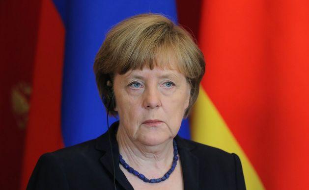 Меркель просит Россию помочь решить проблему беженцев