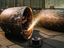 Искры труб, роботы для мороженого и пыль графита. ТОП-5 фоторепортажей 2017 года