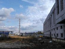 Сэкономили. Недостроенную гостиницу в районе стадиона «Нижний Новгород» прикрыли рекламой