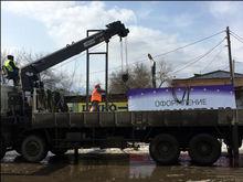 Центр Красноярска зачистили от рекламы: отмыли рекламу на асфальте и сняли щиты с газонов