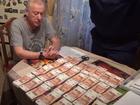 Иконы и пачки денег: в Сети появилось видео обыска в доме Евгения Тефтелева